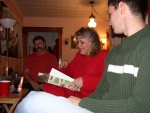 Mom opens her first gift.