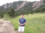 Ben in front of the Flatirons with goofy smile.