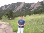 Ben in front of the Flatirons without the goofy smile.