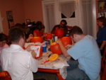 Lori, Dominic, Ben (hidden), Pauline, Andres, Lucas, and Becky hard at work on the hapless pumpkins.