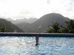 Ben swimming in the La Haut Pool with the Mountains behind