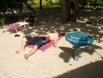 Ben lying on the beach knocked out by a coconut!